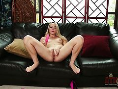 Blonde porn girl Ashley Stone with tiny tities and hairless pussy strips down to her bare skin to masturbate naked