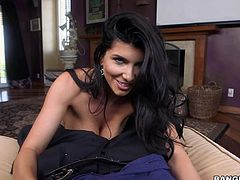 Busty MILF Romi Rain with tattooed back pulls off her panties and rubs her shaved cunt with desire in front of Lexington Steele and then takes his black monster cock. She strokes his big pole like a pro.