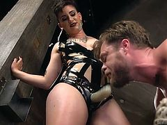 This bitch slave has to taste his mistresses strap on, after she has shoved it deep inside of his asshole. How humiliating. She stretched his hole out really good. The tied up slave has to take what his mistress gives to him.