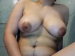 Masturbating Arab with Big Boobs and shaved Pussy