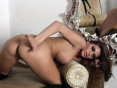Madelyn Marie with giant breasts and shaved cunt strips down to her bare skin for your viewing pleasure