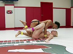 These two hotties love each other to death. And they believe that the only way to keep love fresh, is to make it exciting. That's why they take it to the wrestling floor. Nikki puts on a huge dildo and lets her girl suck it real hard. She then takes her down on the floor and shoves the same dildo in.
