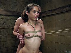 This hot brunette has no idea how to fuck and get fucked. That's why Xander takes her under his wing and assures her a week of tough slave training. He ties her up all naked, including her boobs. She seems to be enjoying it and squats, so that her pussy is all opened up for some quick fucking.