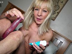 Naughty British mature lady playing with her dildo
