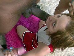 Red haired cheerleader blows three big black cocks attacking her face
