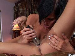 lesbian couple playing with kinky dildos