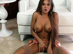 Madison Ivy with massive knockers and shaved beaver is completely naked and plays with her twat non-stop
