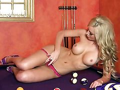 Kayden Kross strips down to her bare skin and masturbates with toy