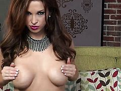 Sabrina Maree with big breasts and clean beaver poses seductively before masturbating