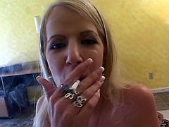 Blonde goddess has a smoke while smoking his meat pole