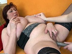 The blonde cutie moans, as she is deeply fingered by the seasoned redheaded milf. The mature redhead knows how to please a woman. Watch as the skinny blonde babe returns the favor and licks the old lesbian's cunt.