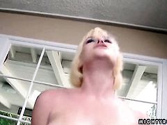 Blonde Naomi Cruise having fun with toy