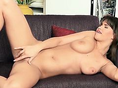 With gigantic boobs and shaved bush fills the hole between her legs with sex toy