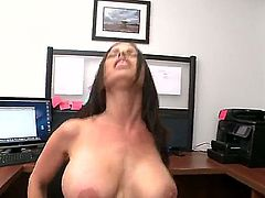 Brandy Aniston is in an office and she is having her huge tits grabbed. Her pussy is penetrated by a large cock on an office chair and she is happy.