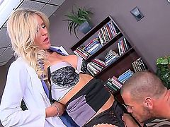 Audrey Show is a blonde that is taking off her uniform before her doctor. She is then having her pussy penetrated in the examination room by his dick.