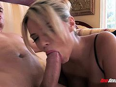 A blonde beauty in lingerie sucks him then gets banged