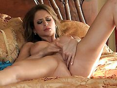 Emily Addison with gigantic tits and shaved snatch takes toy up her bush after sexy striptease