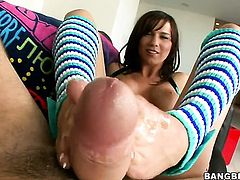 Brunette with nice legs gives a footjob
