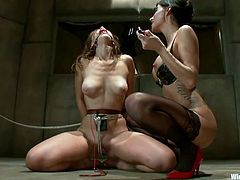Gia has Audrey bound and gagged, and has a dildo stuffed in her cunt, with wires coming out of it. Gia sticks another electric vibrator in her asshole as well, pumping it in and out. The ball gag helps stifle the extremely loud moans of pleasure, coming from the ginger hottie. How many times will she cum?