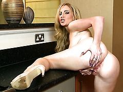 Georgie Lyall with juicy breasts and hairless beaver shows it all as she plays with her pussy