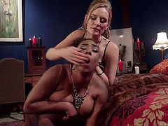 Mona talks Lisa into a little bit of kinky domination. Lisa has never gotten kinky like this before, but she's starting to like it. Mona plays the dominant, spanking Lisa's big, round, brown ass, before spreading her legs wide. Lisa does as she's told and pleasures Mona's wet pussy with her tongue.