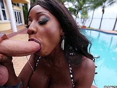 Diamond was outside relaxing by the water in her sexy bikini. She came over to me, feeling really horny. The black beauty said she needed to taste my hard cock so, of course, I let her suck me off hard and fast outside.