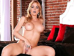 Angela Sommers with big hooters and trimmed twat has fire in her eyes as she bangs herself with sex