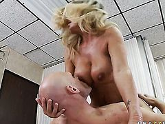 Kristal Summers with giant melons shows off her sexy body as she gets pumped good and hard by Johnny Sins