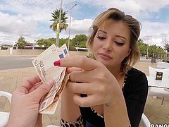 Charming European chick Anna Polina is short on her dough but has a great chance to earn some cash. She bares her big jugs in a public place in front of the camera readily.