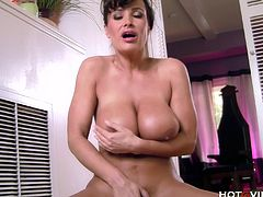 Lisa Ann, world renown MILF and ex porn star, fingers her tasty pussy with the Hotgvibe cock ring while riding a couch pillow until the sex toy gives her a deep, intense orgasm.