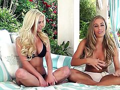 Nicole Aniston with giant breasts fingers her pussy like it aint no thing