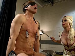 Lorelei loves anything that involves some kinky domination, no matter whether she is the dominant or submissive. Here, she is a nurse, but instead of relieving pain from her patient, she is dishing it out. This guy is blindfolded and is getting whipped, along with clamps on his nipples and more. Sadistic!