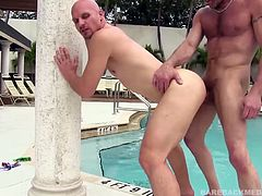 Cole Sexton is at the pool and admiring daddy Chad Brock. This is not lost on Chad, who quickly moves in for a chat. Introductions quickly turn to cock sucking, as Chad goes down on his new found younger friend. He moves from cock sucking to ass rimming, before letting his bottom suck the dick that will soon be fucking him. Rock hard and ready, Chad slides in and barebacks Cole in several positions, as we enjoy some great closeups of the anal action.