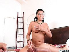 Claudia Valentine keeps her mouth wide open while taking cum facial