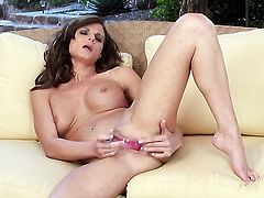 Daisy Lynn with giant jugs and shaved cunt touches her melons gently