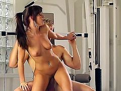 Rahyndee James is a chick with tight small tits. She is having a very sexy workout in the gym. See her close up while she is having her slit penetrated by a dick.