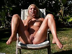 Blonde Brandy Smile stripping for your viewing enjoyment in solo scene