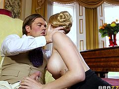 This scene has an older look to it from the clothes being worn. Of course, the clothes don't stay on very long, as Erica's busty body is desirable no matter what is being worn. Her amorous man receives some fantastic oral, looking at her nice tits. He gets behind her and thrusts his stiff dick into her.