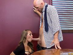 Big breasted beauty Nicole, always looks stunning on her workplace. She is in the boardroom with her coworker and being naughty. The blonde employee wraps her hands around his stiff cock and jacks him off, before being licked in her tight cunt. Her throat is fucked, while her tits are licked.