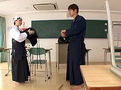 Hot babe Maho, was learning the proper techniques of the ancient art of karate, but her master was feeling turned on and horny. The hot student was also in the mood for sex, so they got intimate right in the classroom! He licks her nipples and uses the cane on her tits.