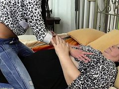 She is new to this lesbian business, but that is OK because this old fat dyke is going to show this young cutie, what it's like to fuck another woman. The mature slut rubs her hands over that soft, nubile pussy and licks the dark haired babe's small boobs.