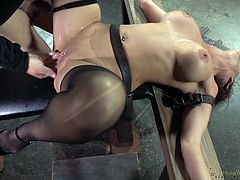 Syren has been secured to a cross-like apparatus via restraints. Her arms are immobilized and her legs are spread apart, allowing her executor and his friend to have their way with her. They fuck her mouth and pussy, and they are not gentle about it, either. Although it's a bit rough, she loves it.