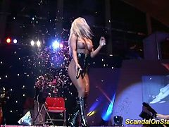 busty blonde stripper doing hot facesitting on public sexfair show stage