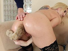 Super sexy blonde MILF Christie Stevens in black stockings and pink shoes shows every inch of her body. Busty woman with shaved pussy flaunts her perfect butt and turns Mark Wood on.