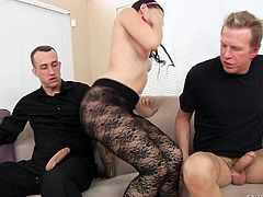 Petite girl Mandy Muse in black pantyhose takes off her black bra and shows her small tits to two lucky dudes. There are two hard dicks for her to handle. She gives double handjob on the couch.