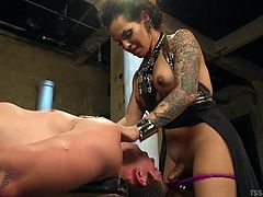 Mean mistress TS Foxxy, shows her slave who is in control. The hot shemale sticks her boobs in her slave's mouth and makes him suck those hot nipples. She rummages around in his asshole with her fingers and prepares him for her big tranny cock.