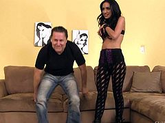 Brunette in black pantyhose Tia Cyrus shows off her tight ass. She bends over in front of man in jeans and he takes a look at her twat from behind. Flirtatious Tia Cyrus is hungry for sex.