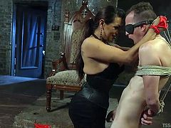There is no place he can go and he can't escape. She has tied him up and he must obey. She is cruel and seductive. Watch as she teases his cock with her whip. When the tranny mistress wants a rimjob, he must do what she asks.