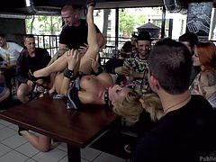 Mandy is hot, but she has an attitude and these fine folks from Public Disgrace are about to bring her down a notch or two. They have her sucking dick and eating pussy on the bar, provided by Isabella. Now it's time for more head and to get roughly fucked, while onlookers watch and take pictures.