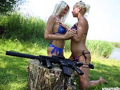 Jessie and her friend are outside today, enjoying the weather as well as the feel of the big gun that they are shooting. The activity is highly arousing, causing the blonde hotties to start in on each other, licking, rubbing and squeezing all over. Big guns, big tits and hot lesbian action!